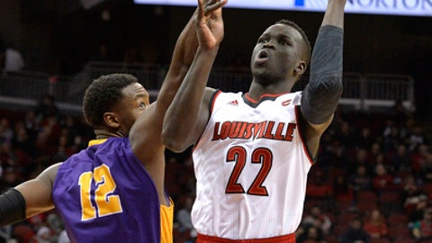 Louisville forward Deng Adel (22) shoots over the defense of Albany forward Devonte Campbell (12) during the second half of an NCAA college basketball game, Wednesday, Dec. 20, 2017, in Louisville, Ky. Louisville won 70-68. (AP Photo/Timothy D. Easley)