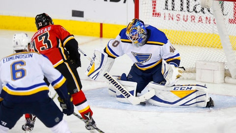 St. Louis Blues goalie Carter Hutton makes a save on Calgary Flames' Johnny Gaudreau during the second period of an NHL hockey game Wednesday, Dec. 20, 2017, in Calgary, Alberta. (Todd Korol/The Canadian Press via AP)