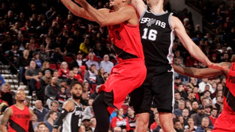 PORTLAND, OR - DECEMBER 20: CJ McCollum #3 of the Portland Trail Blazers goes to the basket against the San Antonio Spurs on December 20, 2017 at the Moda Center in Portland, Oregon. NOTE TO USER: User expressly acknowledges and agrees that, by downloading and or using this Photograph, user is consenting to the terms and conditions of the Getty Images License Agreement. Mandatory Copyright Notice: Copyright 2017 NBAE (Photo by Cameron Browne/NBAE via Getty Images)