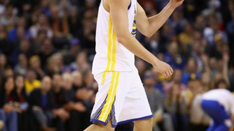 OAKLAND, CA - DECEMBER 20:  Klay Thompson #11 of the Golden State Warriors reacts after the Warriors made a basket against the Memphis Grizzlies at ORACLE Arena on December 20, 2017 in Oakland, California. NOTE TO USER: User expressly acknowledges and agrees that, by downloading and or using this photograph, User is consenting to the terms and conditions of the Getty Images License Agreement.  (Photo by Ezra Shaw/Getty Images)
