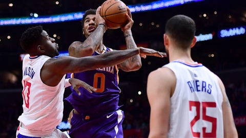 LOS ANGELES, CA - DECEMBER 20:  Marquese Chriss #0 of the Phoenix Suns attempts a shot between the defense of Jamil Wilson #13 and Austin Rivers #25 during a 108-95 Clipper win at Staples Center on December 20, 2017 in Los Angeles, California.  (Photo by Harry How/Getty Images)