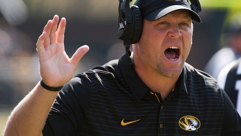 FILE - In this Sept. 16, 2017, file photo, Missouri head coach Barry Odom argues a call during the first half of an NCAA college football game against Purdue, in Columbia, Mo. After falling to 1-5 in October, Missouri coach Barry Odom set fire to all of the Tigers earlier plans and preparation. The mid-season overhaul paid off for Missouri, which won its final six games and will face Texas in the Texas Bowl on Dec. 27.  (AP Photo/L.G. Patterson, File)