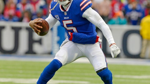 FILE - In this Dec. 17, 2017, file photo, Buffalo Bills quarterback Tyrod Taylor (5) plays during the second half of an NFL football game against the Miami Dolphins,  in Orchard Park, N.Y. The Bills (8-6) take on the Patriots (11-3) on Sunday. (AP Photo/Adrian Kraus, File)