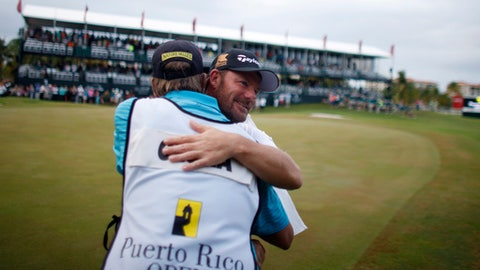 Germany's Alex Cejka, behind, hugs his caddie after winning the Puerto Rico Open golf tournament in Rio Grande, Puerto Rico, Sunday, March 8, 2015. This is Cejka's first PGA Tour title. (AP Photo/Ricardo Arduengo)