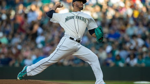 FILE - In this Sept. 2, 2017, file photo, Seattle Mariners starter Yovani Gallardo delivers a pitch during a baseball game against the Oakland Athletics in Seattle. The Brewers have boosted their starting rotation depth, finalizing contracts with free agent right-handers Jhoulys Chacin and Yovani Gallardo. Chacin's two-year deal and Gallardo's one-year agreement were announced by Milwaukee on Thursday, Dec. 21, 2017. (AP Photo/Stephen Brashear, File)