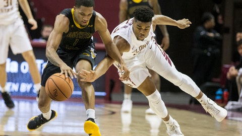Florida State guard M.J. Walker (23) attempts a steal from Southern Mississippi guard Cortez Edwards (1) in the second half of an NCAA college basketball game in Tallahassee, Fla., Thursday, Dec. 21, 2017. Florida State defeated Southern Mississippi 98-45. (AP Photo/ Mark Wallheiser)