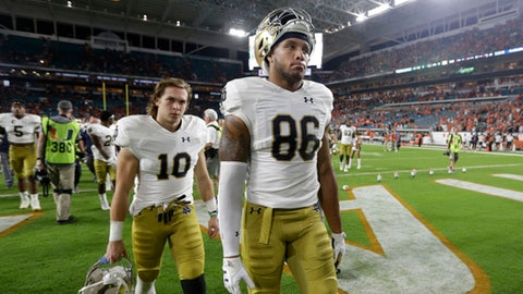 Notre Dame tight end Alize Mack (86) walks off the field after an NCAA college football game against Miami, Saturday, Nov. 11, 2017, in Miami Gardens, Fla. Miami won 41-8. (AP Photo/Lynne Sladky)
