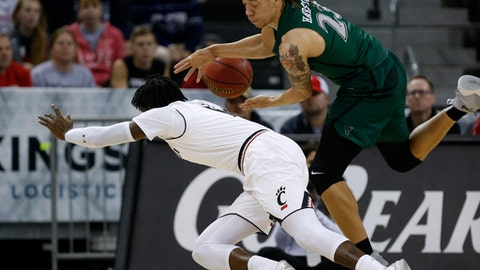 Cincinnati forward Tre Scott, left, knocks the ball from the hands of Cleveland State forward Jamarcus Hairston (23) during the first half of an NCAA college basketball game Thursday, Dec. 21, 2017, in Highland Heights, Ky. (AP Photo/Gary Landers)