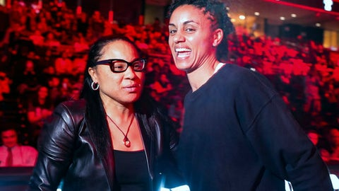 South Carolina's head coach Dawn Staley, left, talk with former Temple player Candice Dupree, right, as Dupree's number gets retired during halftime of an NCAA college basketball game, Thursday, Dec. 21, 2017, in Philadelphia. (AP Photo/Chris Szagola)