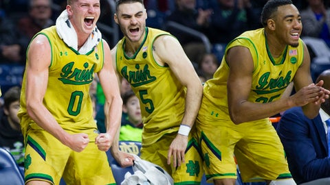 Notre Dame's Rex Pflueger (0) Matt Farrell (5) Bonzie Colson (35) celebrate as a teammate scores during an NCAA college basketball game against Southeastern Louisiana in South Bend, Ind., Thursday, Dec. 21, 2017. (Michael Caterina/South Bend Tribune via AP)