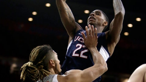 Connecticut guard Terry Larrier shoots over Arizona forward Keanu Pinder (25) during the first half of an NCAA college basketball game Thursday, Dec. 21, 2017, in Tucson, Ariz. (AP Photo/Rick Scuteri)