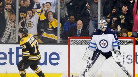 Winnipeg Jets' Connor Hellebuyck (37) stands in the net after Boston Bruins' Charlie McAvoy (73) scored the winning goal in a shootout during an NHL hockey game in Boston, Thursday, Dec. 21, 2017. The Bruins won 2-1. (AP Photo/Michael Dwyer)