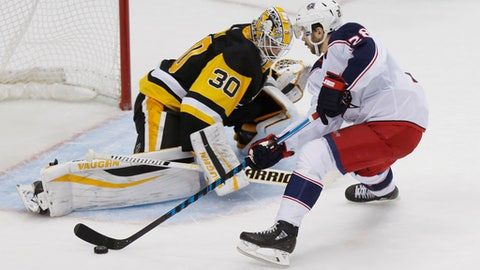 Pittsburgh Penguins goalie Matt Murray (30) makes a save on Columbus Blue Jackets' Oliver Bjorkstrand (28) on the last shot in the shootout of an NHL hockey game, Thursday, Dec. 21, 2017, in Pittsburgh. The Penguins won 3-2. (AP Photo/Keith Srakocic)