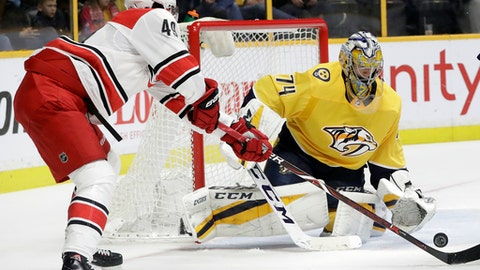 Nashville Predators goalie Juuse Saros (74), of Finland, blocks a shot by Carolina Hurricanes center Victor Rask (49), of Sweden, during the third period of an NHL hockey game Thursday, Dec. 21, 2017, in Nashville, Tenn. The Hurricanes won 4-1. (AP Photo/Mark Humphrey)
