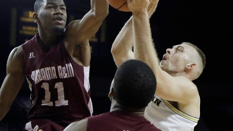 Alabama A&M forward Andre Kennedy (11) reaches in to block a shot by Michigan forward Austin Davis during the second half of an NCAA college basketball game Thursday, Dec. 21, 2017, in Ann Arbor, Mich. (AP Photo/Carlos Osorio)