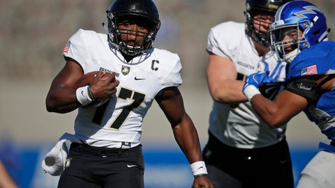 FILE - In this Nov. 4, 2017, file photo, Army quarterback Ahmad Bradshaw (17) carries during the first half of the team's NCAA college football game against Air Force at Air Force Academy, Colo. Two of college football's most dominant rushing attacks will clash when San Diego State faces Army in the Armed Forces Bowl on Saturday, Dec. 23, 2017, even though the two offenses are dramatically different. (AP Photo/David Zalubowski, File)