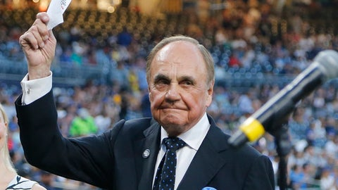 FILE - In this Sept. 29, 2016, file photo, San Diego Padres broadcaster Dick Enberg waves to crowd at a retirement ceremony prior to the Padres' final home baseball game of the season, against the Los Angeles Dodgers in San Diego. Enberg, the sportscaster who got his big break with UCLA basketball and went on to call Super Bowls, Olympics, Final Fours and Angels and Padres baseball games, died Thursday, Dec. 21, 2017. He was 82. Engberg's daughter, Nicole, confirmed the death to The Associated Press. She said the family became concerned when he didn't arrive on his flight to Boston on Thursday, and that he was found dead at his home in La Jolla, a San Diego neighborhood. (AP Photo/Lenny Ignelzi, File)