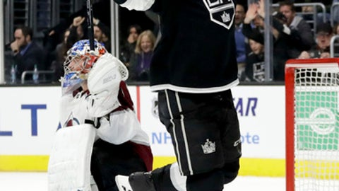 Los Angeles Kings right wing Dustin Brown, right, celebrates after scoring past Colorado Avalanche goalie Semyon Varlamov during overtime in an NHL hockey game in Los Angeles, Thursday, Dec. 21, 2017. The Kings won 2-1. (AP Photo/Chris Carlson)