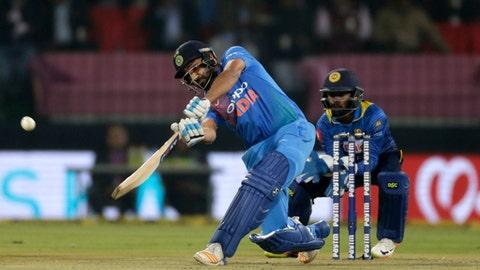 India's captain Rohit Sharma, left, plays a shot during their second Twenty20 international cricket match against Sri Lanka in Indore, India, Friday, Dec. 22, 2017. (AP Photo/Rajanish Kakade)
