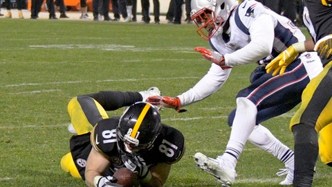 """FILE - In this Sunday, Dec. 17, 2017, file photo, Pittsburgh Steelers tight end Jesse James (81) loses his grip on the football after crossing the goal line on a pass play against the New England Patriots in the closing seconds of the fourth quarter of an NFL football game in Pittsburgh. While coaches, players, fans and broadcasters become puzzled or annoyed by the NFL's """"catch rule,"""" the people in charge of developing and refining it through the years also have struggled. (AP Photo/Don Wright, File)"""