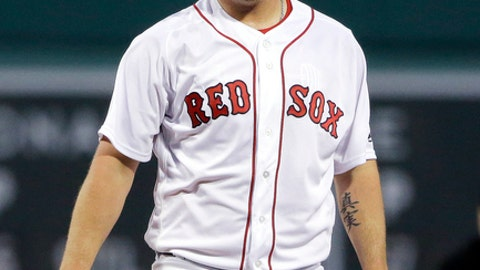 FILE - In this April 12, 2017, file photo, Boston Red Sox pitcher Steven Wright reacts during the first inning of a baseball game against the Baltimore Orioles at Fenway Park in Boston. A domestic assault case involving Wright has been retired for one year, according to a Boston Herald report. Citing a court clerk, the newspaper reported the case was retired Thursday, Dec. 21, 2017, by the Williamson County Courthouse in Tennessee. Wright was initially due in court this week following an arrest on Dec. 8, the Herald said. (AP Photo/Elise Amendola, File