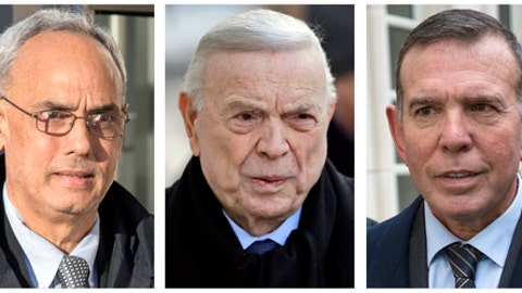 FILE - In these 2017 file photo, three former South American soccer officials, from left, Manuel Burga, of Peru; Jose Maria Marin, of Brazil; and Juan Angel Napout, of Paraguay, accused of accepting millions of dollars in bribes, are shown outside federal court in the Brooklyn borough of New York. The three are among the more than 40 soccer officials, businessmen and entities charged in a scandal that's shaken FIFA, soccer's governing body. (AP Photo/File)