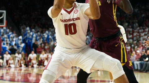 FILE - In this Dec. 9, 2017, file photo, Arkansas forward Daniel Gafford drives to the hoop against Minnesota in the first half of an NCAA college basketball game in Fayetteville, Ark. Gafford arrived at Arkansas with some uncertainty about how quickly he could acclimate to the college game. The 6-foot-11 freshman has quickly put any doubts to rest, shooting nearly 70 percent from the field and leading the surging Razorbacks with 26 dunks through 10 games. (AP Photo/Michael Woods, File)