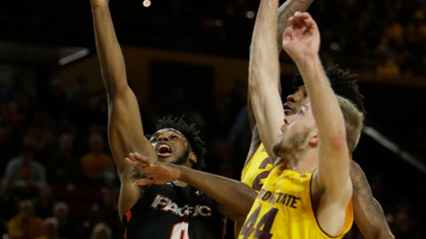 Pacific forward Jahlil Tripp (0) shoots between Arizona State forward Romello White and Arizona State guard Kodi Justice (44) in the first half during an NCAA college basketball game, Friday, Dec 22, 2017, in Tempe, Ariz. (AP Photo/Rick Scuteri)