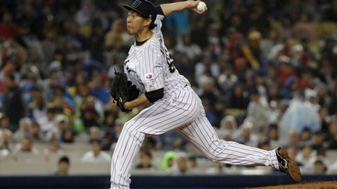 FILE - In this Tuesday, March 21, 2017 file photo, Japan's Yoshihisa Hirano throws during the ninth inning of a semifinal in the World Baseball Classic against the United States, in Los Angeles. Japanese right-hander Yoshihisa Hirano and the Arizona Diamondbacks have agreed to a $6 million, two-year contract. The 33-year-old is looked at to provide bullpen depth and possibly compete to be the team's closer. His deal was announced Friday, Dec. 22, 2017. (AP Photo/Chris Carlson, File)