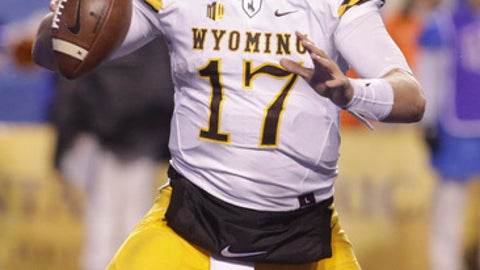 Wyoming quarterback Josh Allen (17) looks for a receiver during the second half of an NCAA college football game against Boise State in Boise, Idaho, Saturday, Oct. 21, 2017. Boise State won 24-14. (AP Photo/Otto Kitsinger)