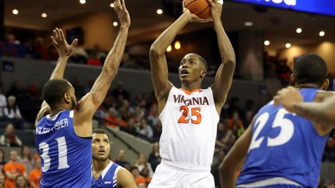 Virginia forward Mamadi Diakite (25) looks for a shot as several Hampton players defend during an NCAA college basketball game Friday, Dec. 22, 2017, in Charlottesville, Va. (AP Photo/Andrew Shurtleff)