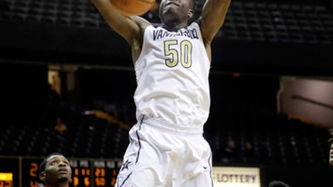 Vanderbilt forward Ejike Obinna (50) dunks the ball in front of Alcorn State's A.J. Mosby (2) and Maurice Howard (5) in the second half of an NCAA college basketball game Friday, Dec. 22, 2017, in Nashville, Tenn. (AP Photo/Mark Humphrey)