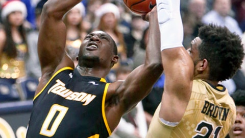 Pittsburgh's Jared Wilson-Frame (0) shoots as Pittsburgh's Terrell Brown (21) defends during the second half of an NCAA college basketball game, Friday, Dec. 22, 2017, in Pittsburgh. (AP Photo/Keith Srakocic)