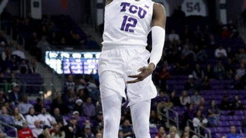 TCU forward Kouat Noi (12) slam-dunks during the first half of an NCAA college basketball game against William & Mary in Fort Worth, Texas, Friday, Dec. 22, 2017. (AP Photo/LM Otero)