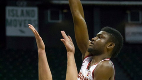 Southern California forward Chimezie Metu (4) shoots over Akron forward Jaden Sayles (23) during the second half of an NCAA college basketball game at the Diamond Head Classic tournament, Friday, Dec. 22, 2017, in Honolulu. (AP Photo/Eugene Tanner)