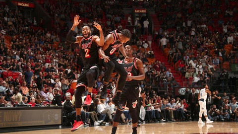 MIAMI, FL - DECEMBER 22: Wayne Ellington #2 and Josh Richardson #0 of the Miami Heat celebrate during the game against the Dallas Mavericks on December 22, 2017 at American Airlines Arena in Miami, Florida. NOTE TO USER: User expressly acknowledges and agrees that, by downloading and/or using this photograph, user is consenting to the terms and conditions of the Getty Images License Agreement. Mandatory Copyright Notice: Copyright 2017 NBAE (Photo by Issac Baldizon/NBAE via Getty Images)