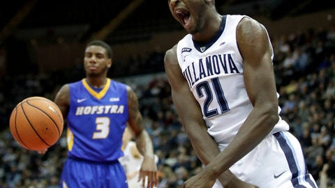 Villanova forward Dhamir Cosby-Roundtree (21) reacts after duking on Hofstra during the first half of an NCAA college basketball game, Friday, Dec. 22, 2017, in Uniondale, N.Y. Villanova won 95-71. (AP Photo/Julio Cortez)