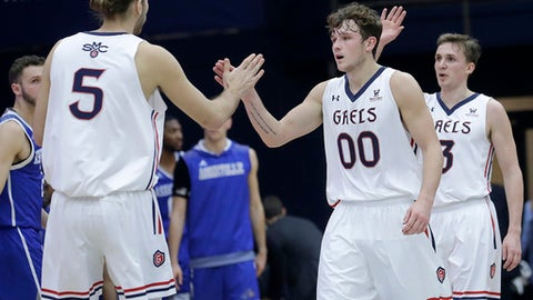 Saint Mary's (Cal.) center Jock Perry (5) celebrates with guard Tanner Krebs (00) and guard Emmett Naar (3) during the second half of an NCAA college basketball game against UNC Asheville in Moraga, Calif., Friday, Dec. 22, 2017. (AP Photo/Jeff Chiu)