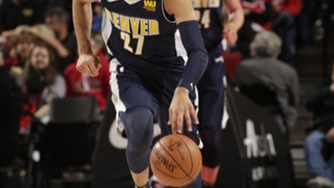 PORTLAND, OR - DECEMBER 22: Jamal Murray #27 of the Denver Nuggets dribbles the ball down court against the Portland Trail Blazers on December 22, 2017 at the Moda Center in Portland, Oregon. NOTE TO USER: User expressly acknowledges and agrees that, by downloading and or using this Photograph, user is consenting to the terms and conditions of the Getty Images License Agreement. Mandatory Copyright Notice: Copyright 2017 NBAE (Photo by Cameron Browne/NBAE via Getty Images)