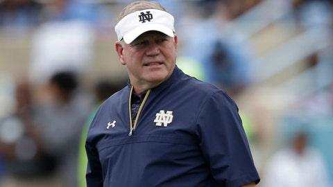 FILE - In this Oct. 7, 2017, file photo, Notre Dame head coach Brian Kelly watches prior to an NCAA college football game against North Carolina in Chapel Hill, N.C. Kelly has to be feeling a bit divided as the Notre Dame head coach prepares the Fighting Irish for their Citrus Bowl clash with No. 16 LSU. (AP Photo/Gerry Broome, File)