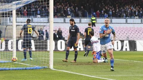 Napoli's Marek Hamsik, right, celebrates after scoring during a Serie A soccer match between Napoli and Sampdoria at the San Paolo stadium in Naples, Italy, Saturday, Dec. 23, 2017. (Ciro Fusco/ANSA via AP)