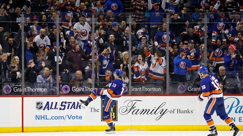 New York Islanders' Mathew Barzal (13) celebrates scoring his second goal in the first period of an NHL hockey game against the Winnipeg Jets, Saturday, Dec. 23, 2017, in New York. (AP Photo/Adam Hunger)