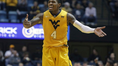 West Virginia guard Daxter Miles Jr. (4) screams at his teammates during the second half of an NCAA college basketball against Fordham game, Saturday, Dec. 23, 2017, in Morgantown, W.Va. (AP Photo/Raymond Thompson)