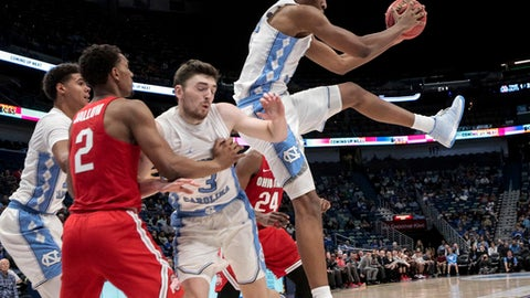 North Carolina forward Sterling Manley (21) comes down with a rebound against Ohio State guard Musa Jallow (2) in the first half of an NCAA basketball game in New Orleans, Saturday, Dec. 23, 2017. (AP Photo/Scott Threlkeld)
