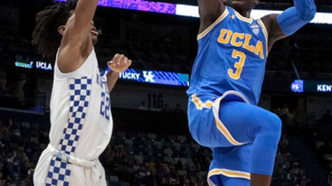UCLA guard Aaron Holiday (3) shoots over Kentucky guard Shai Gilgeous-Alexander (22) in the first half of an NCAA basketball game in New Orleans, Saturday, Dec. 23, 2017. (AP Photo/Scott Threlkeld)