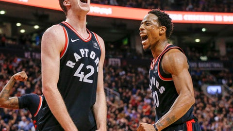TORONTO, ON - DECEMBER 23  - (l-r) Jakob Poeltl and DeMar DeRozan celebrate after a basket during the 2nd half of NBA action as the Toronto Raptors host the Philadelphia 76ers at the Air Canada Centre on December 23, 2017. The Raptors defeated the 76ers 102-86        (Carlos Osorio/Toronto Star via Getty Images)
