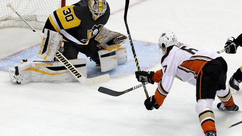 Anaheim Ducks' Rickard Rakell (67) gets a shot past the blocker of Pittsburgh Penguins goalie Matt Murray (30) for a goal in the first period of an NHL hockey game in Pittsburgh, Saturday, Dec. 23, 2017. (AP Photo/Gene J. Puskar)