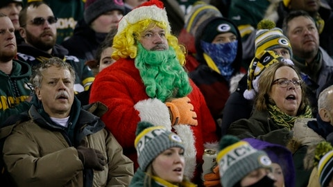 Fans sing the national anthem before an NFL football game between the Green Bay Packers and the Minnesota Vikings Saturday, Dec. 23, 2017, in Green Bay, Wis. (AP Photo/Jeffrey Phelps)