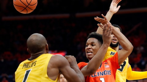 Illinois' Trent Frazier passes the ball as Missouri's Terrence Phillips, left, watches during the first half of an NCAA college basketball game Saturday, Dec. 23, 2017, in St. Louis. (AP Photo/Jeff Roberson)