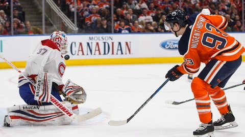Montreal Canadiens goalie Antti Niemi (37) makes a save against Edmonton Oilers' Ryan Nugent-Hopkins (93) during second-period NHL hockey game action in Edmonton, Alberta, Saturday, Dec. 23, 2017.(Jason Franson/The Canadian Press via AP)